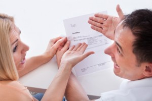 Shocked couple receiving NBN bill